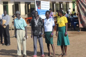 Alfred Gordon, Emmanuel Lukudu and two female pupils they attend class together